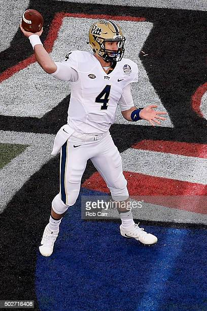 Quarterback Nathan Peterman of the Pittsburgh Panthers throws a first quarter pass against the Navy Midshipmen during the Military Bowl at NavyMarine...