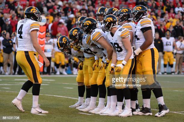 Quarterback Nathan Stanley of the Iowa Hawkeyes huddles with the offense against the Nebraska Cornhuskers at Memorial Stadium on November 24 2017 in...