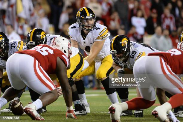 Quarterback Nathan Stanley of the Iowa Hawkeyes looks over the line against the Nebraska Cornhuskers at Memorial Stadium on November 24 2017 in...