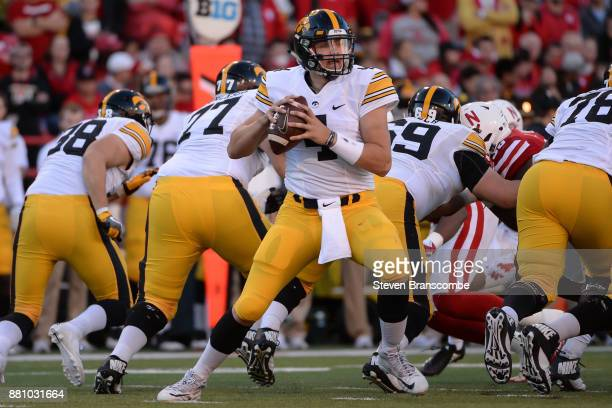 Quarterback Nathan Stanley of the Iowa Hawkeyes looks to pass against the Nebraska Cornhuskers at Memorial Stadium on November 24 2017 in Lincoln...