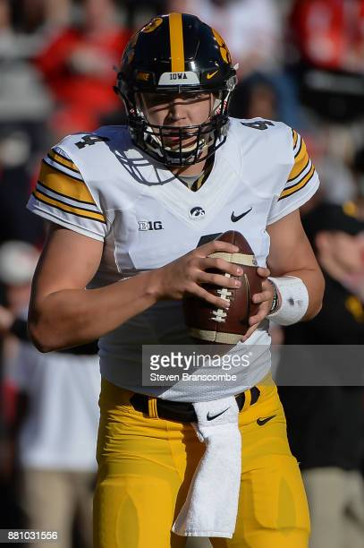 Quarterback Nathan Stanley of the Iowa Hawkeyes warms up before the game against the Nebraska Cornhuskers at Memorial Stadium on November 24 2017 in...