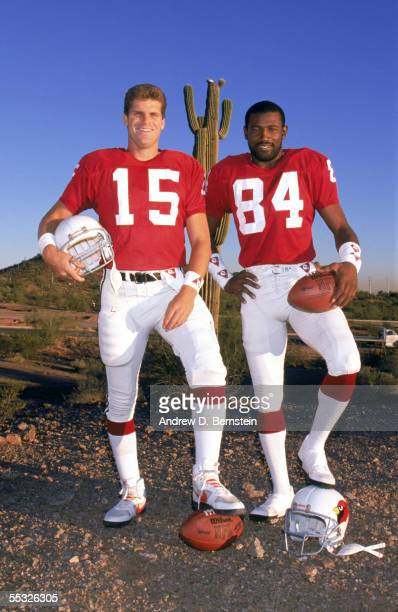 Quarterback Neil Lomax and wide receiver J T Smith of the Phoenix Cardinals pose for a 1988 NFL season portrait
