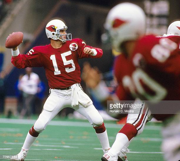 Quarterback Neil Lomax of the St Louis Cardinals passes during a game against the New York Giants on November 18 l984 at Giants Stadium in East...