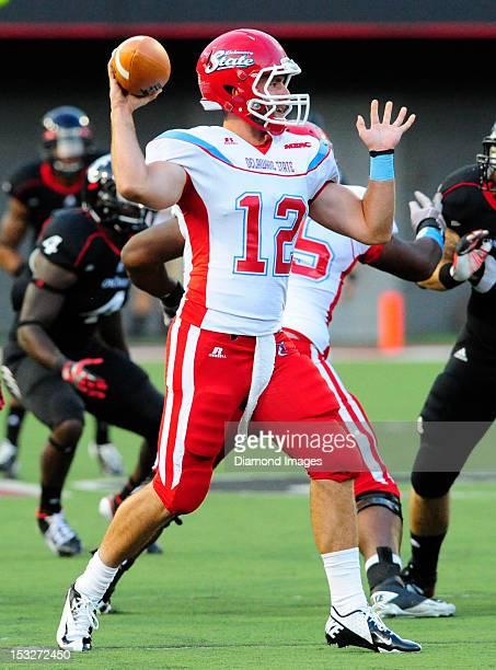 Quarterback Nick Elko of the Delaware State Hornets throws a pass during a game with the Cincinnati Bearcats during a game with the Delaware State...