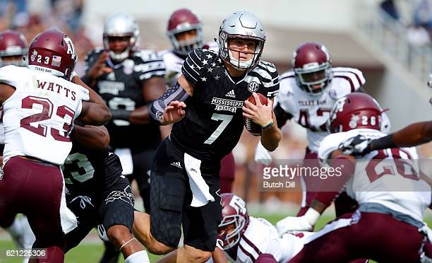 Quarterback Nick Fitzgerald of the Mississippi State Bulldogs carries the ball during the first half of an NCAA college football game against the...