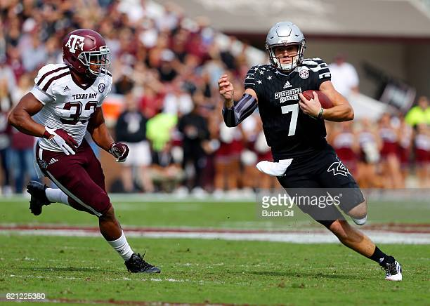 Quarterback Nick Fitzgerald of the Mississippi State Bulldogs scrambles for a first down as he gets around linebacker Shaan Washington of the Texas...