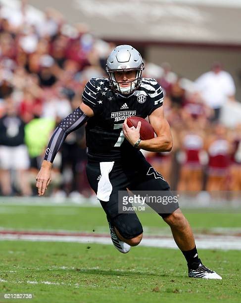 Quarterback Nick Fitzgerald of the Mississippi State Bulldogs scrambles for a first down during the first half of an NCAA college football game...