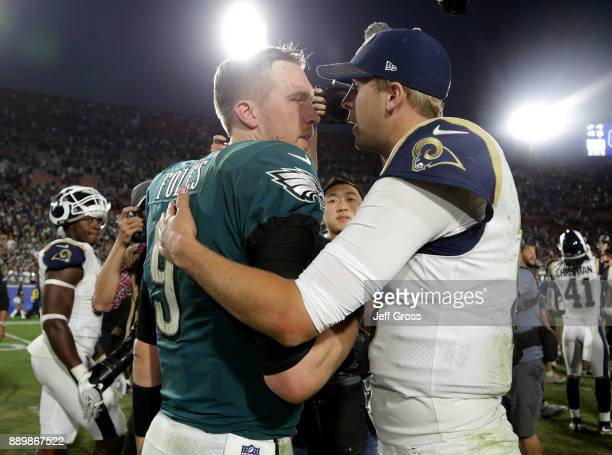 Quarterback Nick Foles of the Philadelphia Eagles and quarterback Jared Goff of the Los Angeles Rams shake hands at the conclusion of the game at Los...