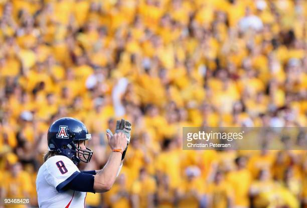 Quarterback Nick Foles of the Arizona Wildcats calls a time out during the college football game against the Arizona State Sun Devils at Sun Devil...