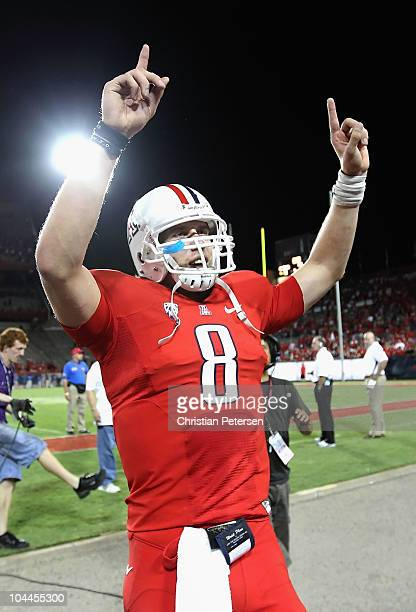 Quarterback Nick Foles of the Arizona Wildcats celebrates after defeating the California Bears in the college football game at Arizona Stadium on...