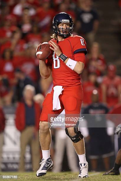 Quarterback Nick Foles of the Arizona Wildcats throws a pass against the Oregon Ducks during the college football game at Arizona Stadium on November...