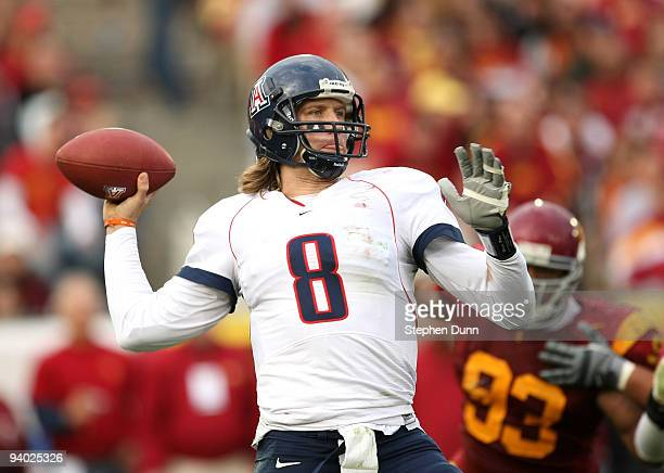 Quarterback Nick Foles of the Arizona Wildcats throws a pass against the USC Trojans on December 5 2009 at the Los Angeles Coliseum in Los Angeles...
