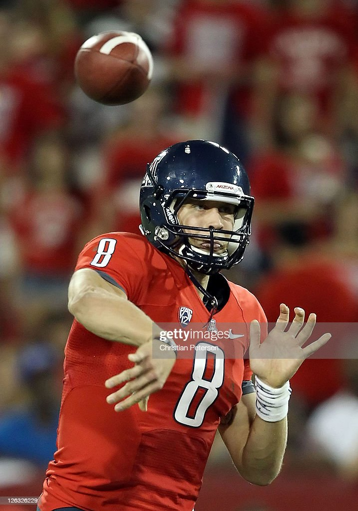 Quarterback Nick Foles #8 of the Arizona Wildcats throws a pass during the college football game against the Oregon Ducks at Arizona Stadium on September 24, 2011 in Tucson, Arizona. The Ducks defeated the Wildcats 56-31.