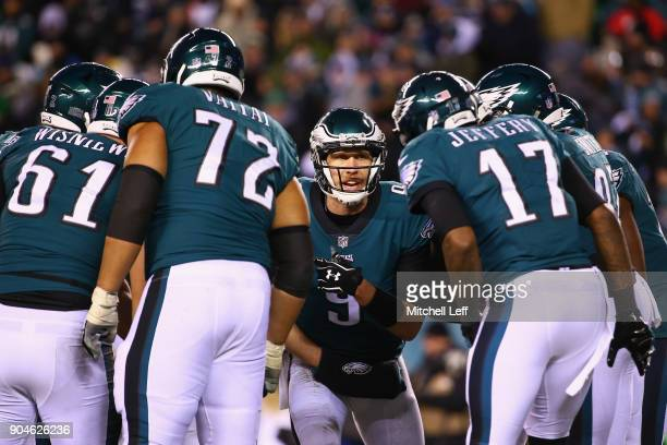 Quarterback Nick Foles of the Philadelphia Eagles and teammates defensive end Aziz Shittu offensive tackle Halapoulivaati Vaitai and wide receiver...