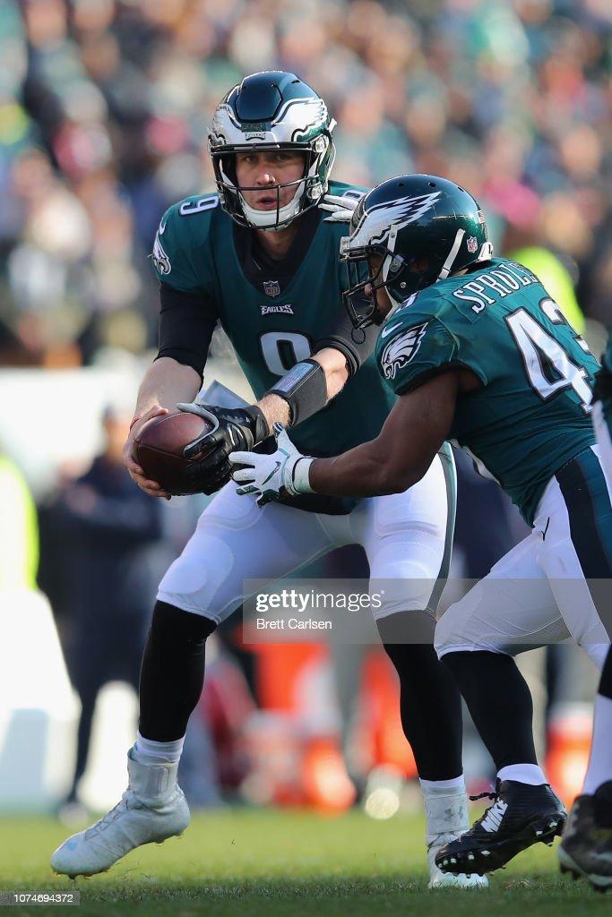 Quarterback Nick Foles of the Philadelphia Eagles fakes a handoff to ... 55695de87