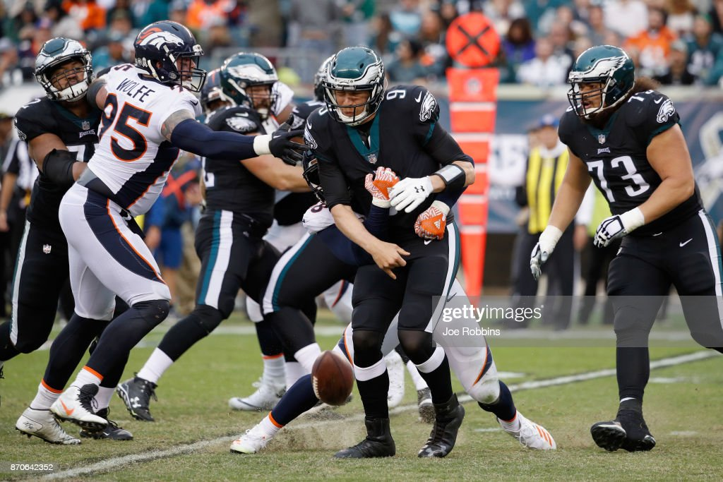 Quarterback Nick Foles #9 of the Philadelphia Eagles fumbles the ball as he is sacked by middle linebacker Jordan Hicks #58 of the Philadelphia Eagles during the fourth quarter at Lincoln Financial Field on November 5, 2017 in Philadelphia, Pennsylvania.