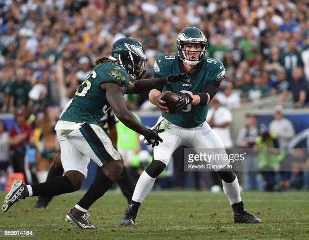 Quarterback Nick Foles of the Philadelphia Eagles hands off the ball to running back Jay Ajayi of the Philadelphia Eagles during the fourth quarter...