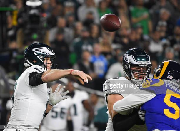 Quarterback Nick Foles of the Philadelphia Eagles makes a pass in the first quafirst quarter against the Los Angeles Rams at Los Angeles Memorial...