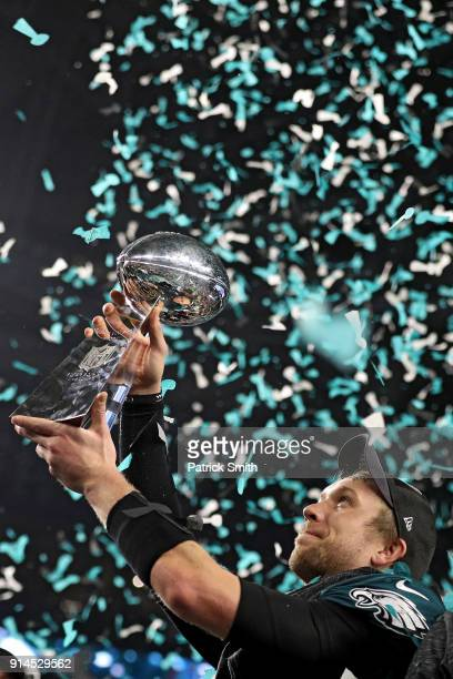 Quarterback Nick Foles of the Philadelphia Eagles raises the Vince Lombardi Trophy after defeating the New England Patriots 4133 in Super Bowl LII at...