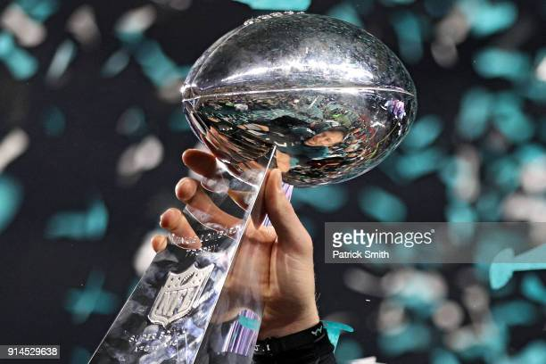Quarterback Nick Foles of the Philadelphia Eagles raises the Vince Lombardi Trophy after defeating the New England Patriots, 41-33, in Super Bowl LII...