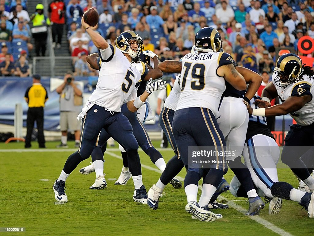Quarterback Nick Foles #5 of the St. Louis Rams drops back for a pass against the Tennessee Titans during the first half of a pre-season game at LP Field on August 23, 2015 in Nashville, Tennessee.