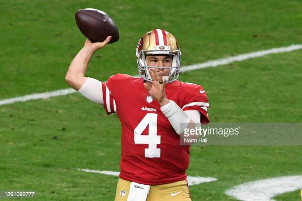 Quarterback Nick Mullens of the San Francisco 49ers delivers a pass against the defense of the Washington Football Team the first quarter of the game...