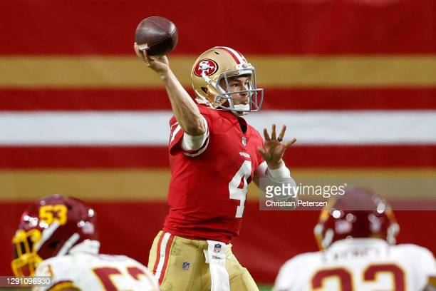 Quarterback Nick Mullens of the San Francisco 49ers delivers a pass against the defense of the Washington Football Team in the second quarter of the...
