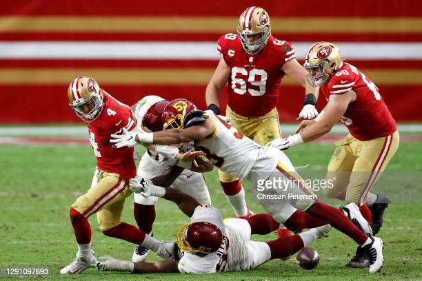 Quarterback Nick Mullens of the San Francisco 49ers fumbles the ball against the defense of the Washington Football Team in the second quarter of the...