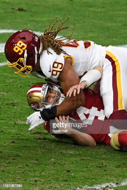 Quarterback Nick Mullens of the San Francisco 49ers is sacked by defensive end 11#99 of the Washington Football Team during the first quarter of the...