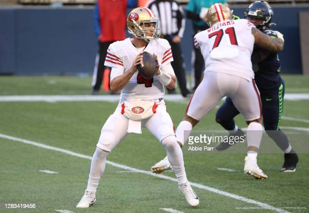 Quarterback Nick Mullens of the San Francisco 49ers looks to pass against the Seattle Seahawks in the fourth quarter at CenturyLink Field on November...