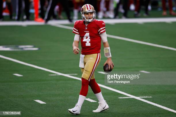 Quarterback Nick Mullens of the San Francisco 49ers reacts to an offensive penalty against the Dallas Cowboys during the first quarter at AT&T...