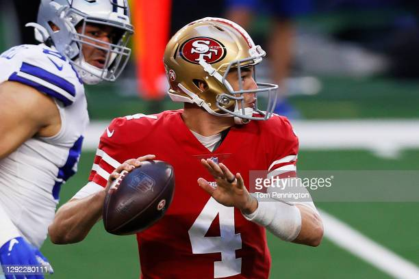 Quarterback Nick Mullens of the San Francisco 49ers throws against the Dallas Cowboys during the first quarter at AT&T Stadium on December 20, 2020...