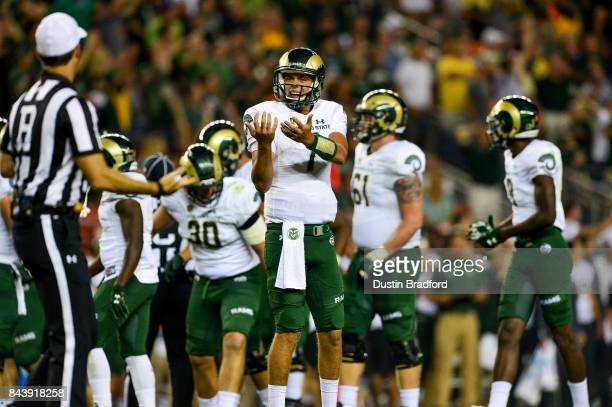 Quarterback Nick Stevens of the Colorado State Rams asks for clarification from a referee during a game against the Colorado Buffaloes at Sports...