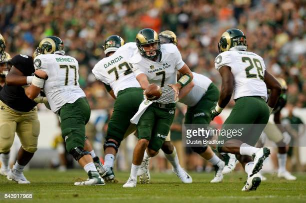 Quarterback Nick Stevens of the Colorado State Rams hands off against the Colorado Buffaloes at Sports Authority Field at Mile High on September 1...