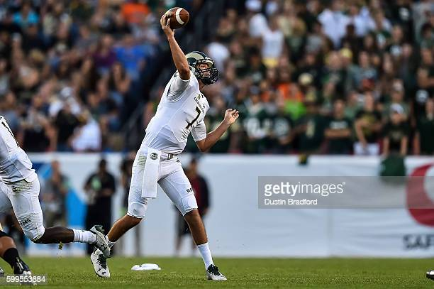 Quarterback Nick Stevens of the Colorado State Rams passes against the Colorado Buffaloes during a game at Sports Authority Field at Mile High on...