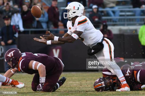 Quarterback N'Kosi Perry of the Miami Hurricanes throws a completed pass to himself against the Virginia Tech Hokies in the first half at Lane...