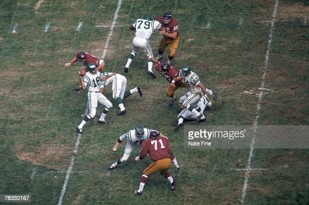 Quarterback Norm Snead of the Philadelphia Eagles drops back to pass against the Washington Redskins at RFK Stadium on October 6 1968 in Washington...