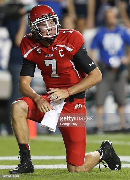 Quarterback of the Utah Utes Travis Wilson takes a knee during a game against the BYU Cougars during the first half of an NCAA football game...