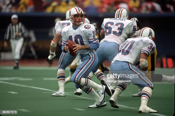 Quarterback Oliver Luck of the Houston Oilers drops back to pass against the Pittsburgh Steelers at Three Rivers Stadium on November 4 1984 in...