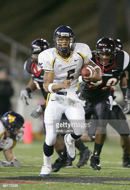 Quarterback Pat White of the West Virginia Mountaineers runs the ball during the game against the Cincinnati Bearcats at Nippert Stadium on November...