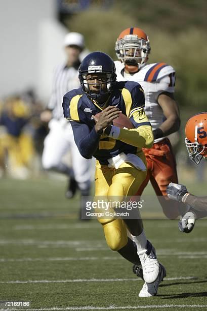 Quarterback Pat White of the West Virginia University Mountaineers runs the ball against the Syracuse University Orange at Milan Puskar Stadium...