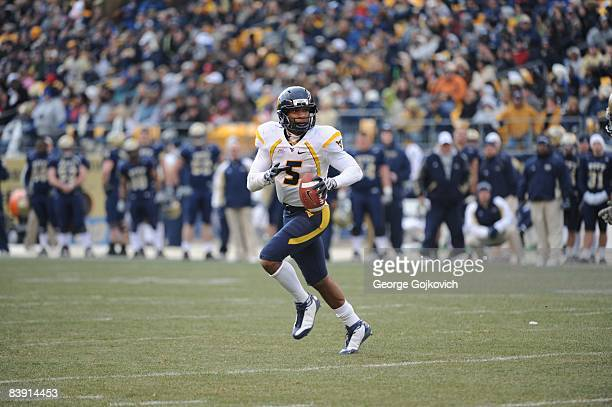 Quarterback Pat White of the West Virginia University Mountaineers runs the football during a Big East Conference college football game against the...