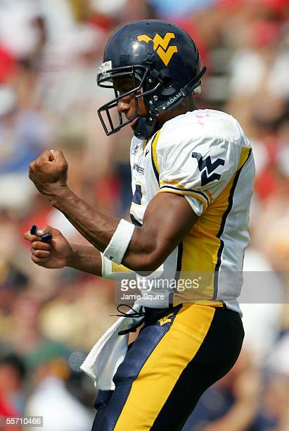 Quarterback Pat White of West Virginia celebrates after a touchdown during the second half of the game against Maryland on September 17 2005 at Byrd...