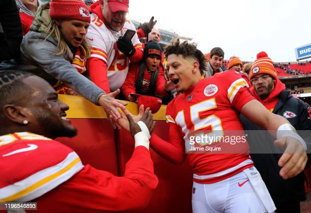 Quarterback Patrick Mahomes and defensive end Frank Clark of the Kansas City Chiefs celebrate with fans after the Chiefs defeated the Los Angeles...