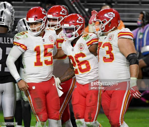 Quarterback Patrick Mahomes and offensive guard Nick Allegretti congratulate running back Le'Veon Bell of the Kansas City Chiefs after he rushed for...