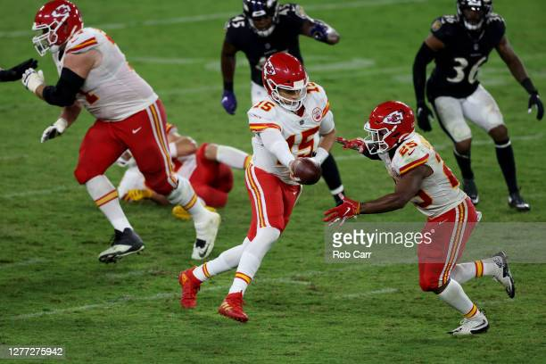 Quarterback Patrick Mahomes hand the ball off to running back Clyde Edwards-Helaire of the Kansas City Chiefs against the Baltimore Ravens at M&T...