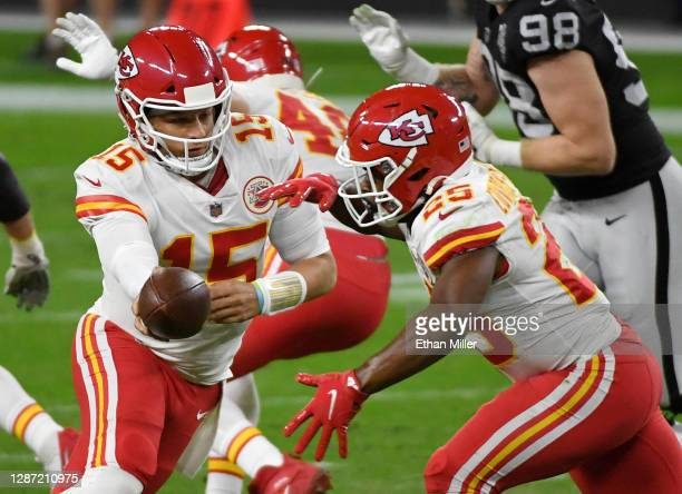Quarterback Patrick Mahomes hands the ball to running back Le'Veon Bell of the Kansas City Chiefs in the first half of their game against the Las...