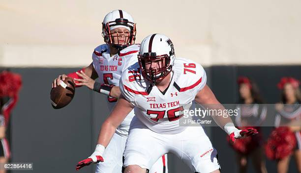 Quarterback Patrick Mahomes II of the Texas Tech Red Raiders looks to pass as offensive lineman Paul Stawarz of the Texas Tech Red Raiders blocks...