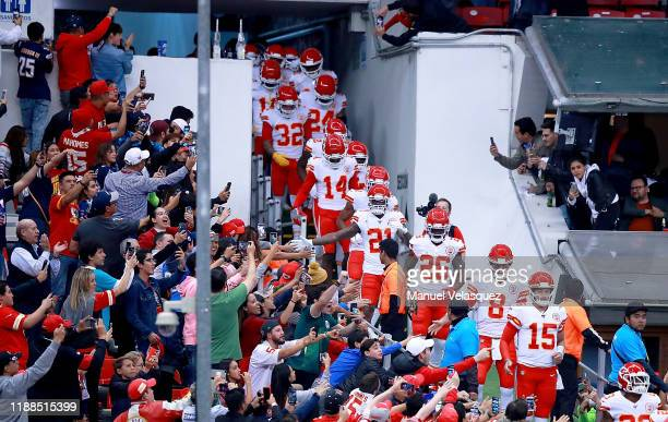 Quarterback Patrick Mahomes of the Kansas City Chiefs and team walk on to the field for warmups before the game against the Los Angeles Chargers at...