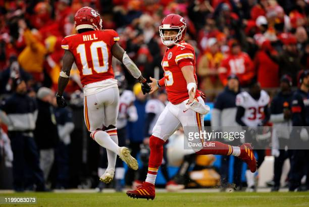 Quarterback Patrick Mahomes of the Kansas City Chiefs and Tyreek Hill celebrate a touchdown pass to Travis Kelce in the second quarter of the AFC...